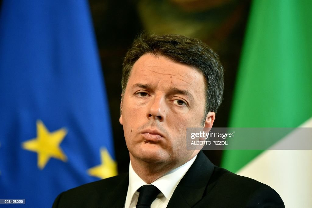 Italian Prine Minister Matteo Renzi gives a news conference with the German Chancelor in Rome's Palazzo Chigi on May 5, 2016. EU president Donald Tusk travels to Rome Thursday with fellow EU institution leaders and German Chancellor Angela Merkel for two days of talks likely to focus on next steps in Europe's migrant crisis. Prime Minister Matteo Renzi, who fears Italy becoming the new migrant frontline after the closure of the Balkan route, will host the first day of talks, followed by Pope Francis on Friday. PIZZOLI