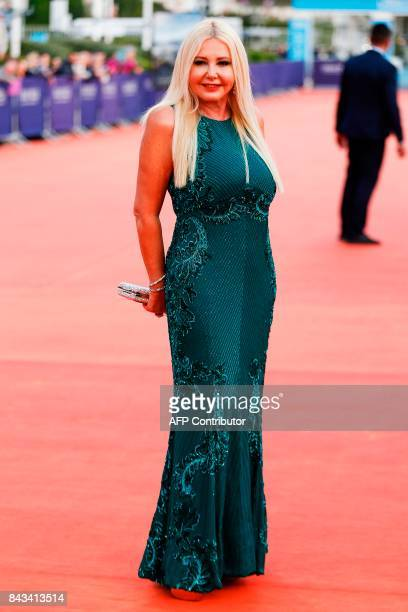 Italian producer Monika Bacardi poses as she arrives for the screening of 'The Music of Silence' on September 6 2017 during the 43rd Deauville US...