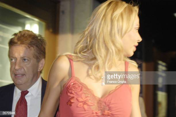 Italian producer Vittorio Cecchi Gori with his girlfriend actress Valeria Marini arrive at the premiere of the restored 1977 movie 'Una Giornata...