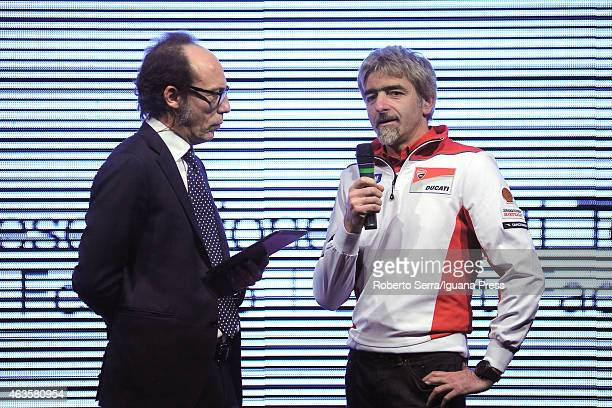 Italian project manager and engineer Luigi Dall'Igna and journalist Guido Meda unveil the Ducati Desmosedici Moto GP 2015 Championship at Ducati...