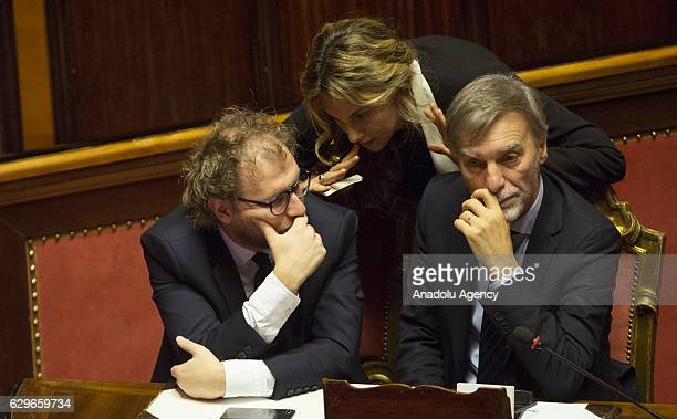 Italian Public Administration and Simplification Minister Marianna Madia talks to Sport Minister Luca Lotti and Infrastructure and Transport Minister...