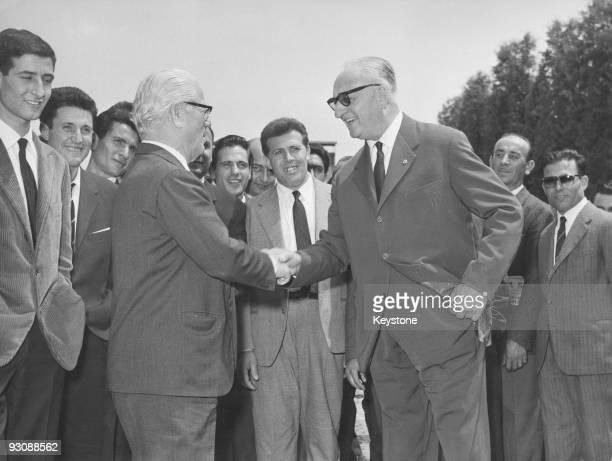 Italian race car driver and businessman Enzo Ferrari meets automobile designer Battista 'Pinin' Farina in Maranello northern Italy circa 1958 They...