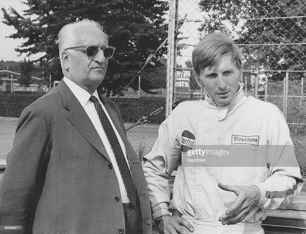 Italian race car driver and businessman Enzo Ferrari with English racing driver Derek Bell during training for the 10th Gran Premio della Lotteria di...
