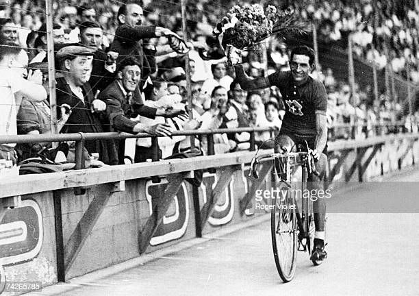 Italian racing cyclist Gino Bartali celebrating his Tour de France victory 31st July 1938