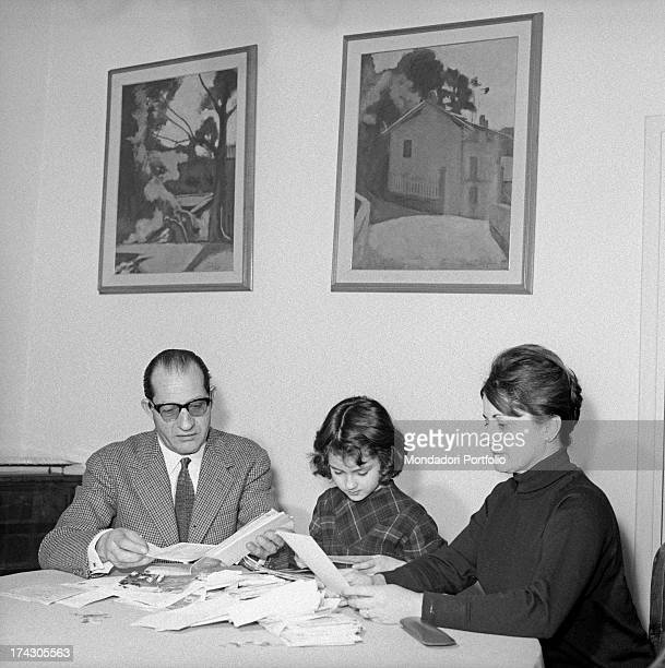 Italian racing cyclist Gino Bartali his wife Adriana Bani and their daughter Bianca Maria Bartali reading the letters sent by the fans Florence 1960s