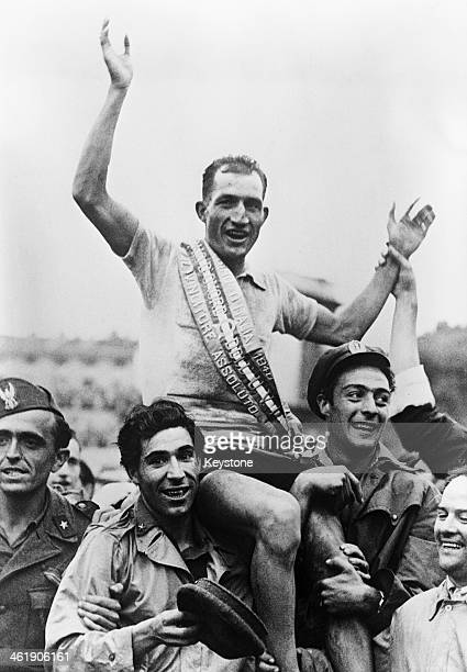 Italian racing cyclist Gino Bartali on the shoulders of spectators after winning the Giro d'Italia Milan 7th July 1946