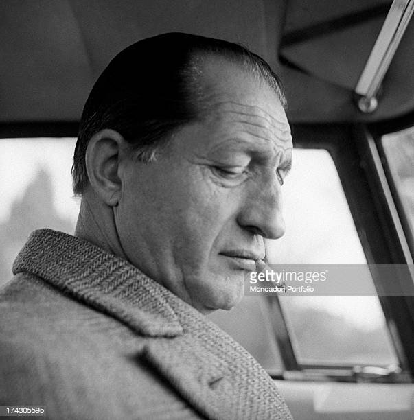 Italian racing cyclist Gino Bartali smoking in the car Florence 1960s