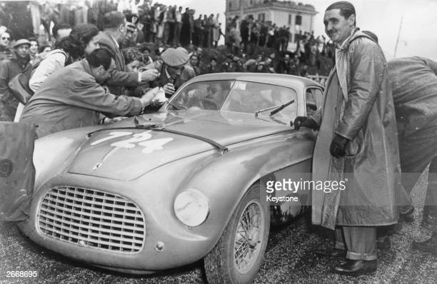 Italian racing driver Giannino Marzotto by his Ferrari 195S Berlinetta in Rome during the Mille Miglia race