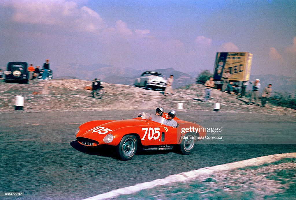 Italian racing driver Umberto Maglioli and his navigator Luciano Monteferrario on the Futa Pass in the TuscanEmilian Apennines in a Ferrari 118LM...