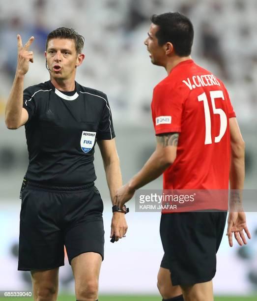 Italian referee Gianluca Rocchi gestures during the Qatar Emir Cup Final football match between AlSadd and AlRayyan at the Khalifa International...