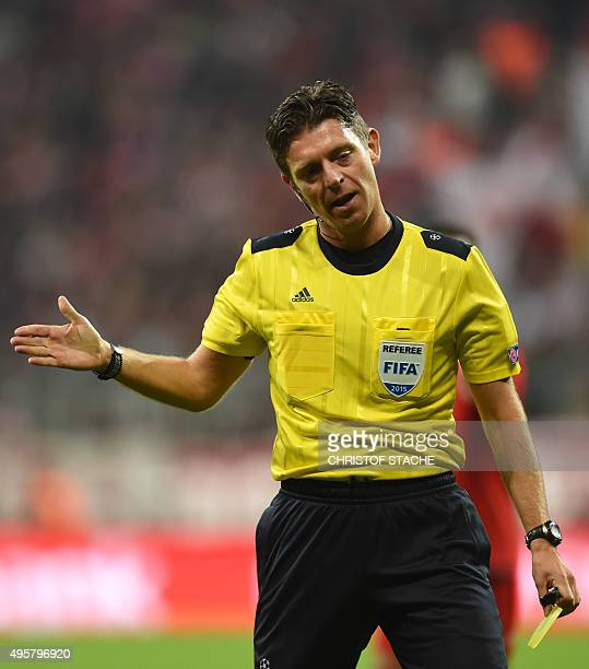 Italian referee Gianluca Rocchi gestures during the UEFA Champions League Group F secondleg football match between FC Bayern Munich and Arsenal FC in...