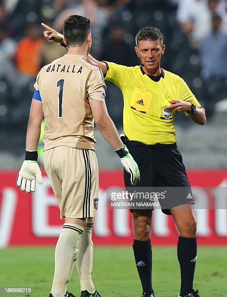 Italian referee Gianluca Rocchi gestures to Augusto Batalla goal keeper of Argentina to leave the pitch after giving him a red card during Argentina...