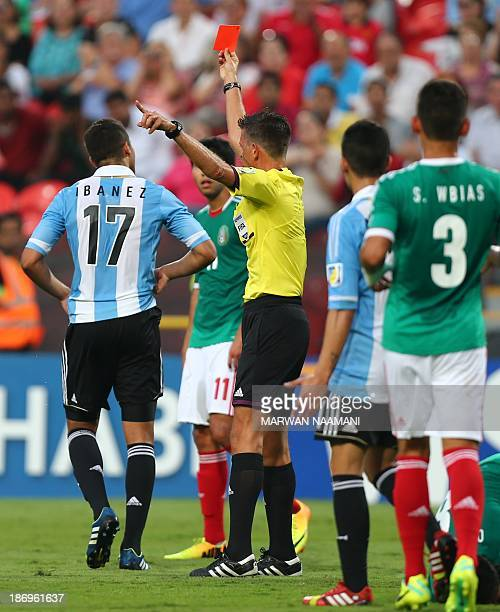 Italian referee Gianluca Rocchi gives the red card to Joaquin Ibanez of Argentina during the Argentina and Mexico semifinal of the FIFA U17 World Cup...
