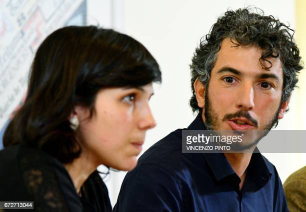 Italian reporter and documentary filmmaker specializing in migrant issues Gabriele Del Grande looks to his wife Alexandra D'Onofrio during a press...