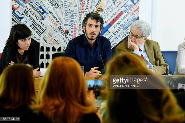 Italian reporter and documentary filmmaker specializing in migrant issues Gabriele Del Grande next to his wife Alexandra D'Onofrio and politician...