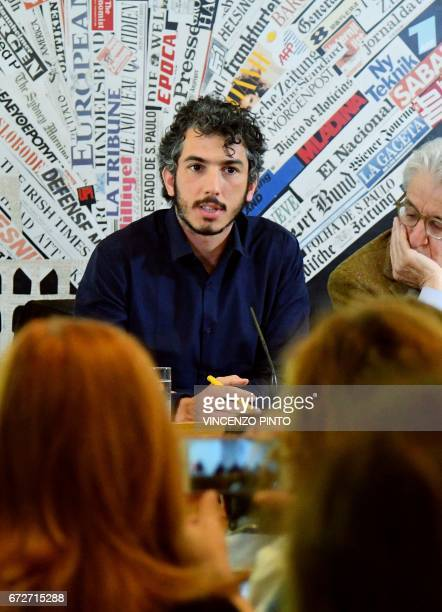 Italian reporter and documentary filmmaker specializing in migrant issues Gabriele Del Grande speaks next to politician Luigi Manconi during a press...