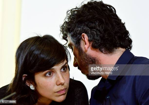 Italian reporter and documentary filmmaker specializing in migrant issues Gabriele Del Grande speaks with his wife Alexandra D'Onofrio during a press...