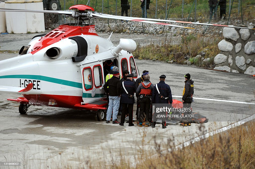 Italian rescuers carry out of a helicopter the body of one of the two climbers who were stranded for over a week in the Mont Blanc massif on November...