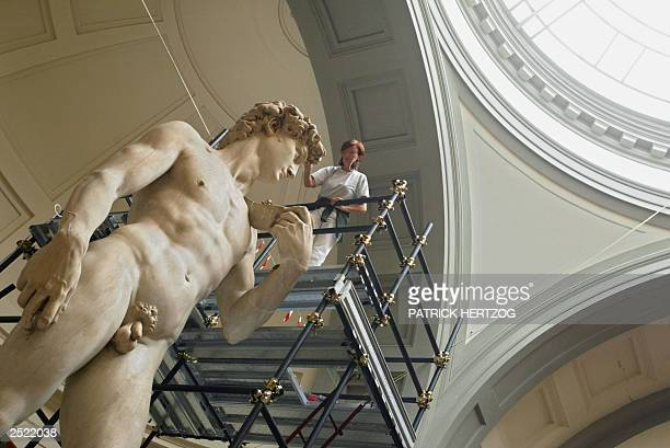 Italian restorer Cinzia Parnigoni works on cleaning one of the world's most famous statues in the world Michelangelo's David 15 September 2003 at the...