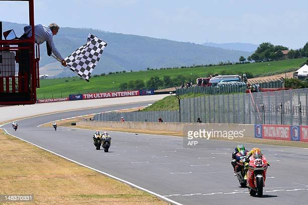 Italian rider Andrea Iannone of Speed Up crosses the finish line to win the Italian Moto2 Grand Prix at the Mugello Circuit on July 15 2012 AFP PHOTO...