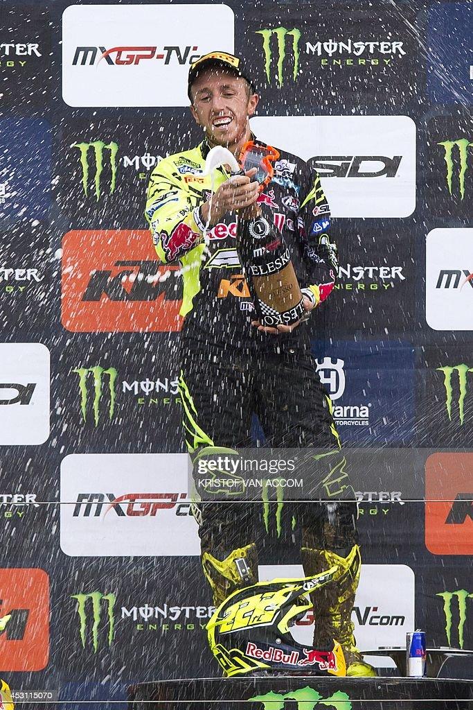 Italian rider Antonio Cairoli celebrates on the podium after competing in the motocross MXGP Belgian Grand Prix, on August 3, 2014, in Lommel. AFP PHOTO / BELGA / KRISTOF VAN ACCOM **Belgium Out**