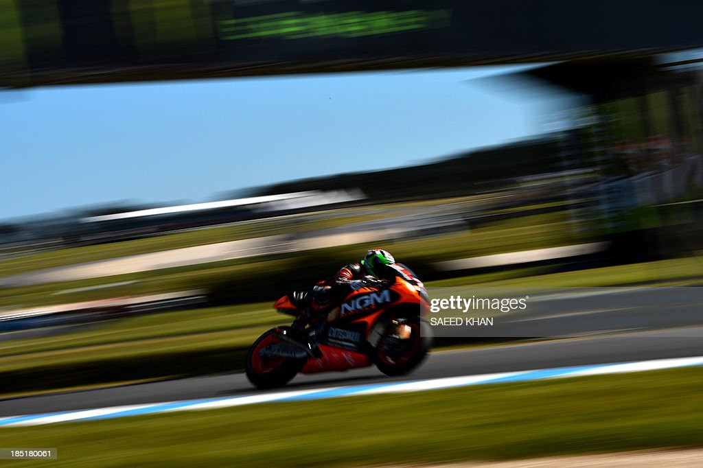 Italian rider Claudio Corti of NGM Mobile Forward Racing powers his Kawasaki during the second practice session of the Australian MotoGP Grand Prix at Phillip Island on October 18, 2013. AFP PHOTO/ Saeed KHAN USE