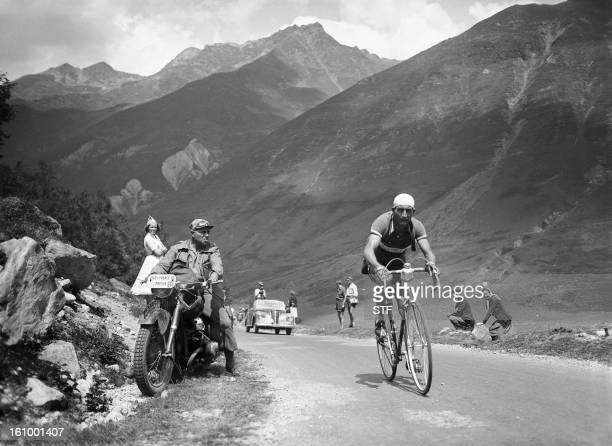Italian rider Gino Bartali rides uphill on July 25 1950 in the Pyrenees mountains during the 11th stage of the Tour de France between Pau and...