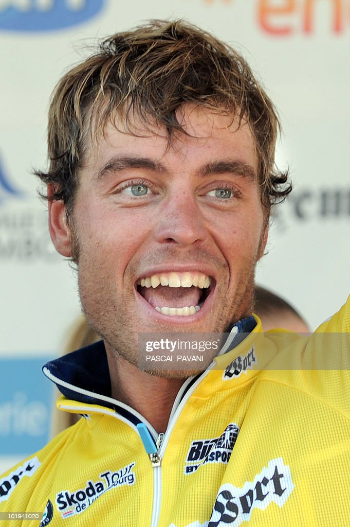 Italian rider <b>Matteo Carrara</b> celebrates his leaders&#39;s yellow jersey on the ... - italian-rider-matteo-carrara-celebrates-his-leaderss-yellow-jersey-on-picture-id101941020