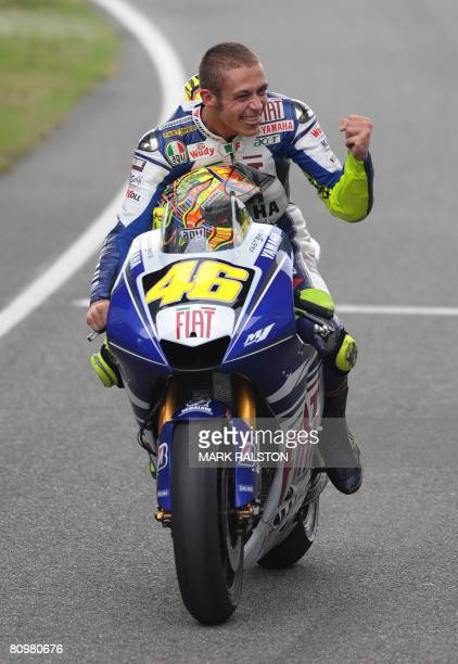 Italian rider Valentino Rossi from the Yamaha Team celebrates as he returns to the pits after winning the China Grand Prix at the Shanghai...