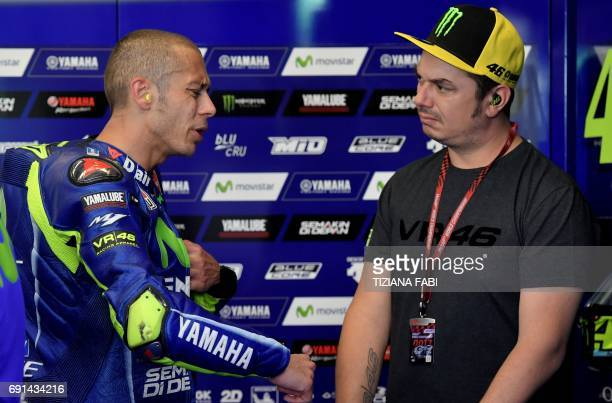 Italian rider Valentino Rossi grimaces in the box during the Free Practice session ahead of the Italian motorcycling Grand Prix at the Mugello...