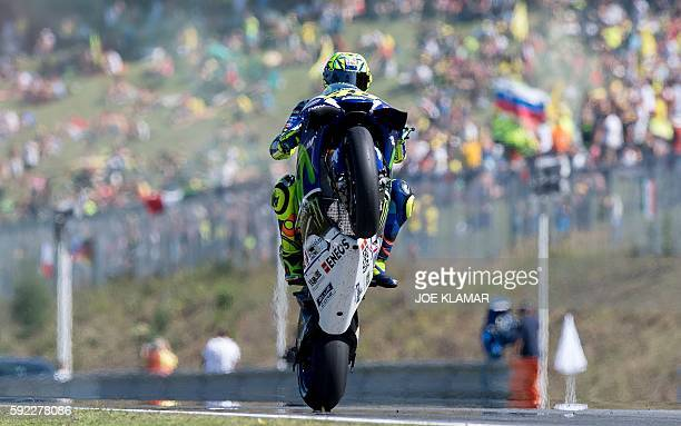 Italian rider Valentino Rossi of Movistar Yamaha MotoGP makes a wheelie during the qualification of the MotoGP Grand Prix on August 20 2016 in Brno...