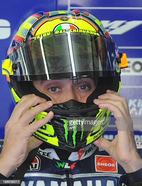 Italian Rider Valentino Rossi sits in the pits before the second free practice session at Le Mans' circuit western France on May 17 2013 two days...
