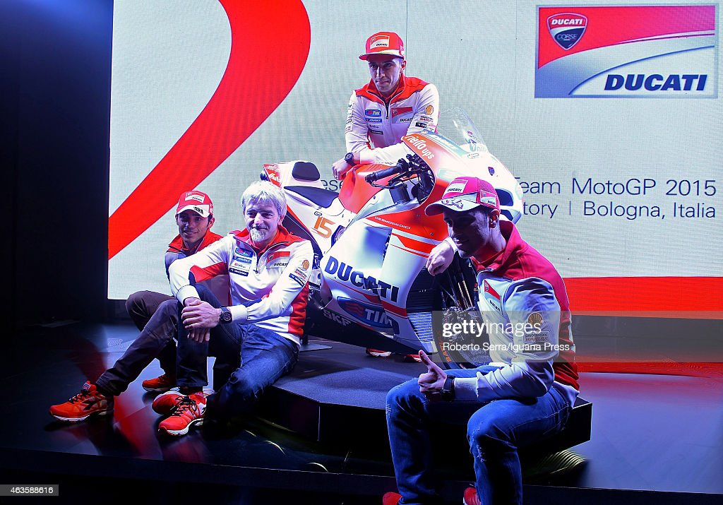 Italian riders <a gi-track='captionPersonalityLinkClicked' href=/galleries/search?phrase=Andrea+Dovizioso&family=editorial&specificpeople=559970 ng-click='$event.stopPropagation()'>Andrea Dovizioso</a> (R); Michele Pirro (L) and <a gi-track='captionPersonalityLinkClicked' href=/galleries/search?phrase=Andrea+Iannone&family=editorial&specificpeople=5314381 ng-click='$event.stopPropagation()'>Andrea Iannone</a> (UP) and engineer Luigi Dall'Igna unveil the Ducati Desmosedici Moto GP 2015 Championship at Ducati Factory on February 16, 2015 in Bologna, Italy.