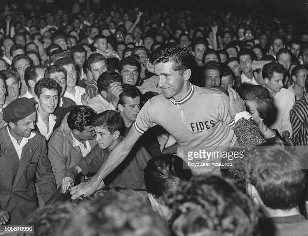 Italian road cyclist Arnaldo Pambianco is greeted by hundreds of fans as he arrives in his home town after winning the Tour of Italy race Bertinoro...