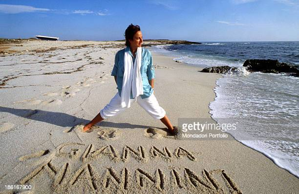 Italian rock singer Gianna Nannini wrote her name in the sand Italy 1980s