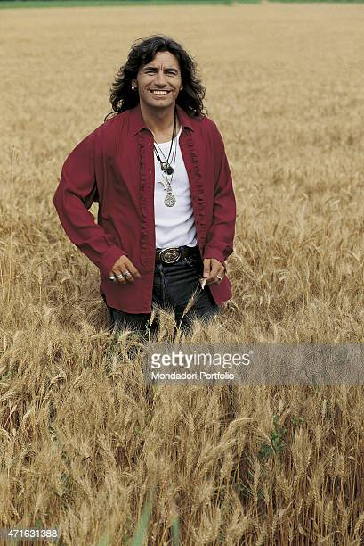 'Italian rocker Luciano Ligabue posing smiling in a corn field for a photo shooting shooted in the countryside around Reggio Emilia Correggio July...