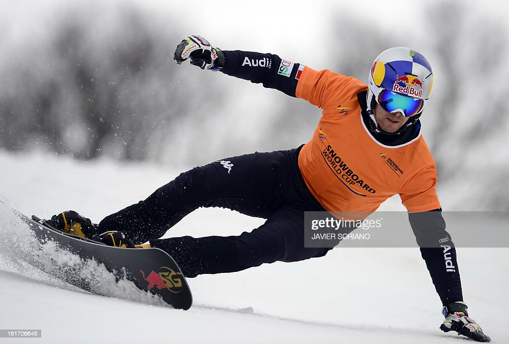 Italian Roland Fischnaller competes in a Snowboard Men's Parallel Giant Slalom final race during the Snowboarding and Free Style World Cup Test Event at the Snowboard and Free Style Centre in Rosa Khutor near the Russian Black Sea resort of Sochi on February 14, 2013. Austrian Andreas Prommegger won the race ahead of Austrian Ingemar Walder and Slovenian Rok Flander.