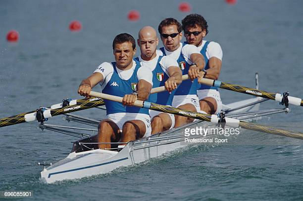 Italian rowers Valter Molea Riccardo Dei Rossi Lorenzo Carboncini and Carlo Mornati compete for Italy to win the silver medal in the coxless four...