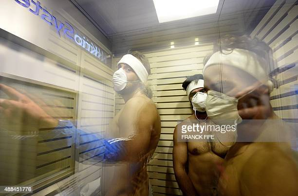 Italian Rugby players stand in a cryotherapy chamber at the University of Surrey in Guildford south England on September 16 2015 2015 aheard of the...