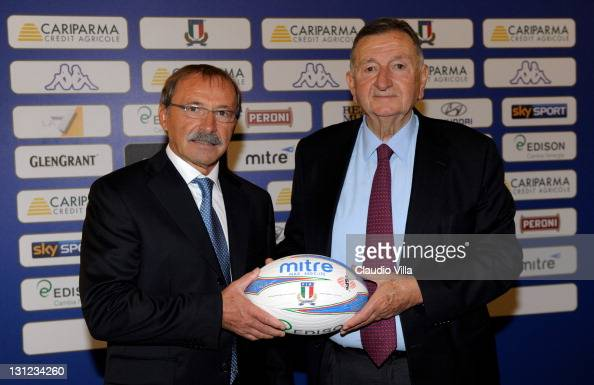 Italian Rugby's new coach Jacques Brunel and FIR president Giancarlo Dondi pose with a ball during Italian Rugby Federation Unveils New Coach Jacques...