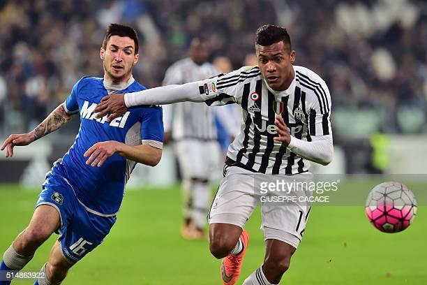 Italian Sassuolo's midfielder Matteo Politano vies for the ball with Juventus' Brazilian defender Alex Sandro during the Italian Serie A football...