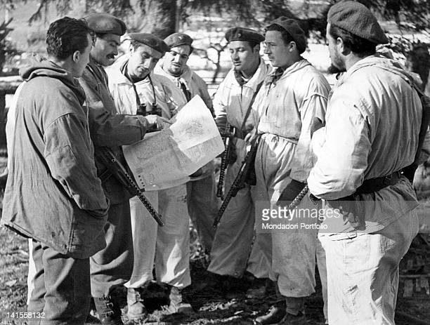 Italian scouts from the Allied Armies are briefed by their commander before the action Emilia Romagna January 1945