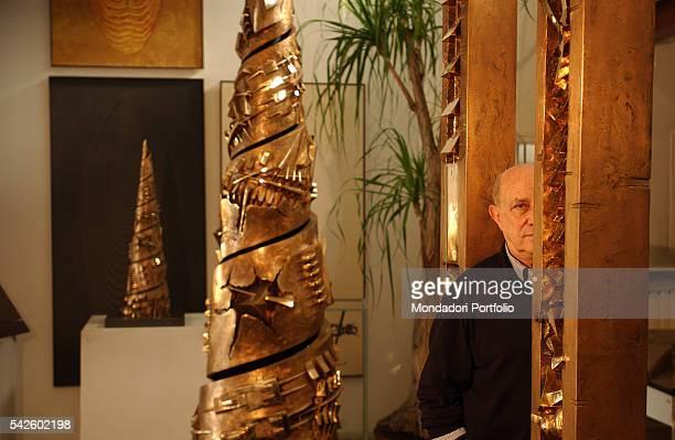 Italian sculptor Arnaldo Pomodoro among his works in his atelier in Milan near the Navigli Milan 19th June 2002