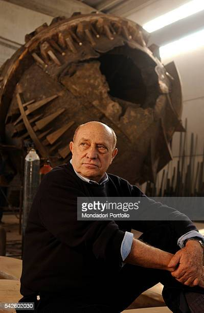 Italian sculptor Arnaldo Pomodoro posing in front of the Grande Sfera being created for the Exhibition in the PalaisRoyal gardens in Paris Milan 19th...