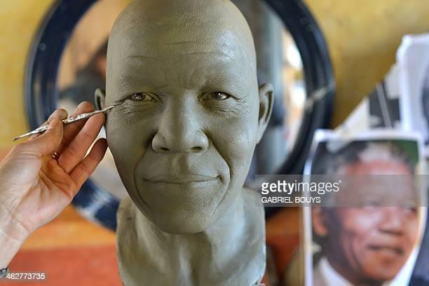 Italian sculptor Francesca Romana Di Nunzio works on a statue representing late Nelson Mandela in her studio in Rome on January 15 2014 The statue...