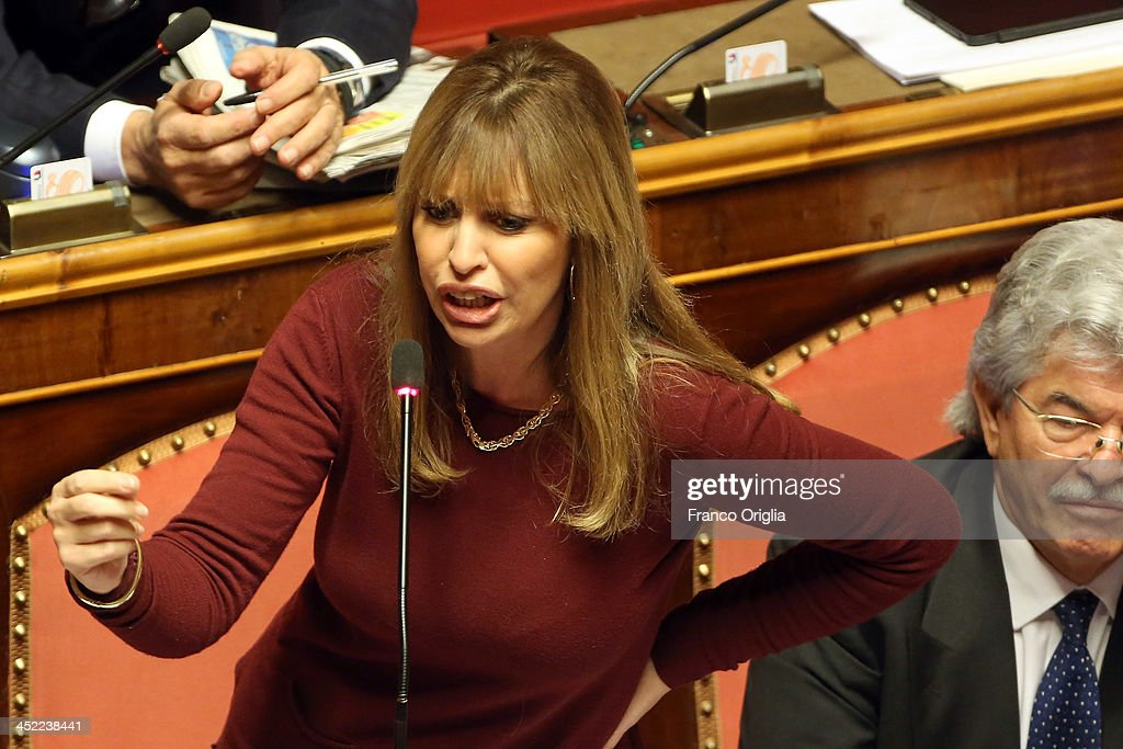 Italian Senator <a gi-track='captionPersonalityLinkClicked' href=/galleries/search?phrase=Alessandra+Mussolini&family=editorial&specificpeople=243183 ng-click='$event.stopPropagation()'>Alessandra Mussolini</a> (Benito Mussolini's granddaughter and Sophia Loren's niece) holds her pro-Berlusconi speech during the discussion before the votes over Silvio Berlusconi's Parliament expulsion on November 27, 2013 in Rome, Italy. Italian Senators will vote today on whether to expel the center-right leader and former Prime Ministre Silvio Berlusconi from parliament over a conviction for tax fraud.