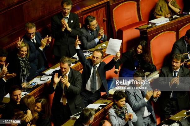 Italian senators of the Five Star Movement celebrate before the vote on the expulsion of former Prime Minister Silvio Berlusconi from the Senate on...
