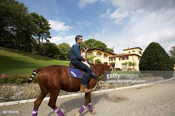 Italian shoe designer Alberto Moretti is photographed riding a horse with one of his daughters for Madame Figaro on October 8 2014 in his villa in...