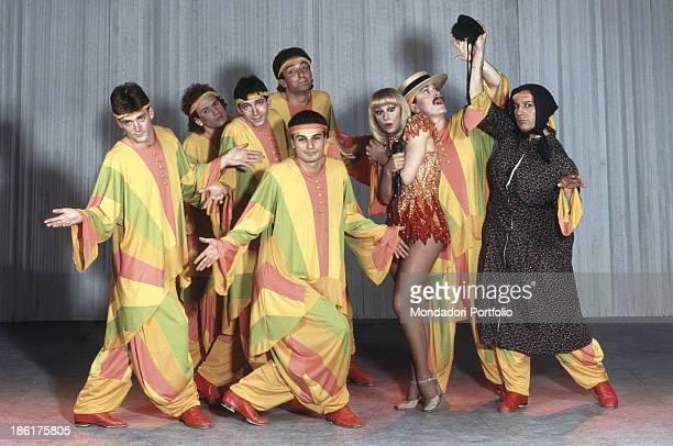 Italian showgirl and TV presenter Raffaella Carrà wearing a stage costume and looking surprised in the talk show Pronto Raffaella Some dancers and a...