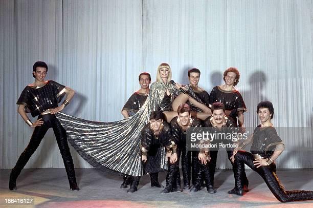 Italian showgirl Raffaella Carrà posing with her ballet company 1983